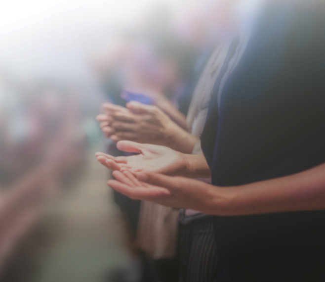 blurred of Christian worship with raised hand,music concert.